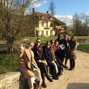 Students in the Hameau de la Reine at Versailles