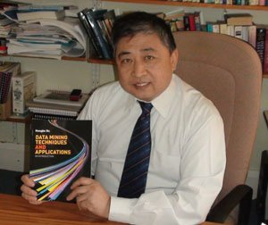 Hongbo Du with his book