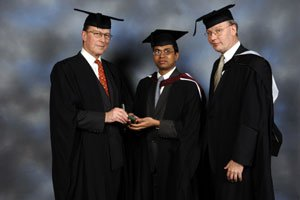 Dhiren Chandrakant Chauhan (centre) with Mr Shenfield and Mr Lewis