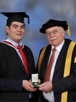 Michael Randall being presented with the medal by the Chancellor, Lord Tanlaw
