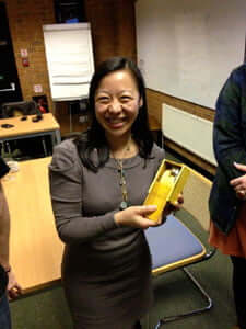 Linda Cheung receives an eco-mouse from BBE students