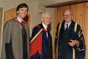 Professor Ronald Coase at Buckingham in 1995 with Sir Richard Luce (now Baron Luce of Adur) the then Vice Chancellor, and Professor Martin Ricketts