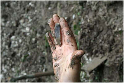 hand-with-Mesolithic-tool