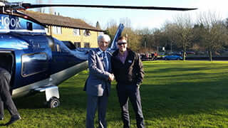 Nigel Adams greets Adam McGill who arrived at Buckingham by helicopter