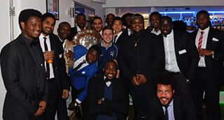 The winning UBFC team celebrates at the University