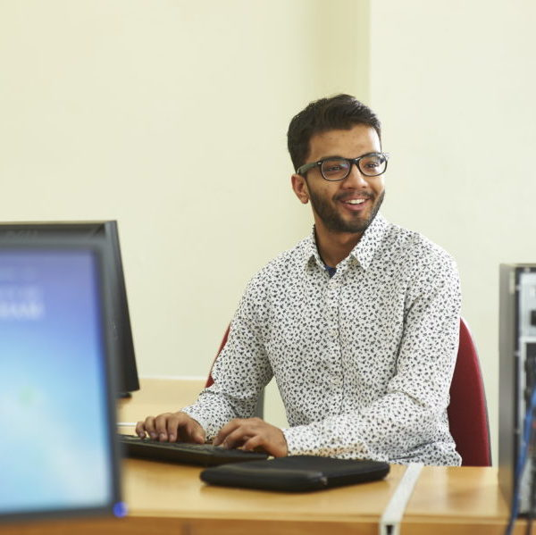 Male student working on a computer