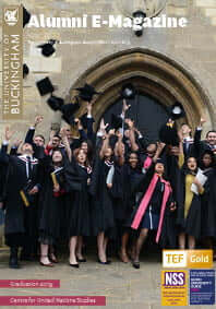 Alumni newsletter magazine front over picturing graudates throwing caps