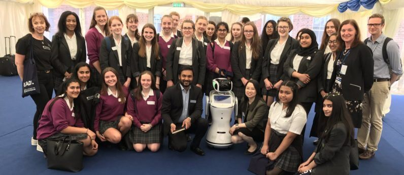 Pupilsfrom Bedford School for Girls taking part in a workshop with a robot