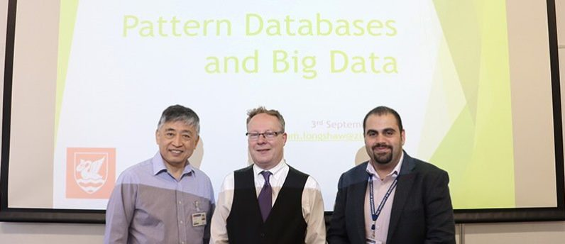 Staff giving a presentation on pattern data and big databases